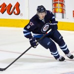hi-res-184774438-jacob-trouba-of-the-winnipeg-jets-keeps-an-eye-on-the_crop_exact